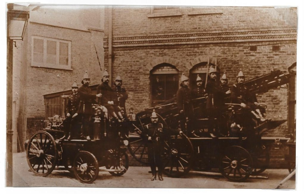 1910 firemen with fire engine and horses