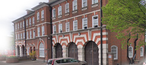 three storey fire station with striking brick and stone stripes