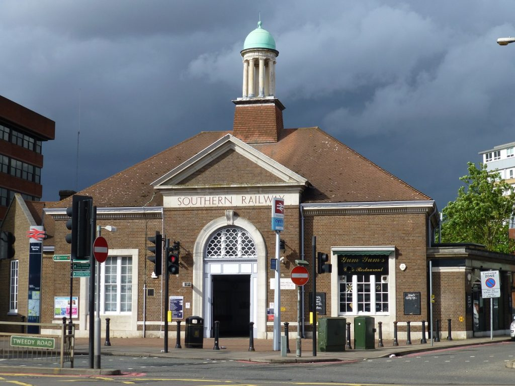 Neo-classical station with arched doorway and cupula