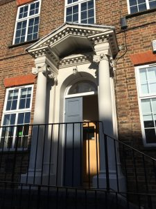 fine classic portico with curled column tops