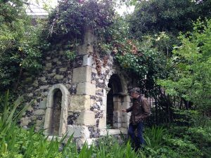 stone and flint mini tower with arched window