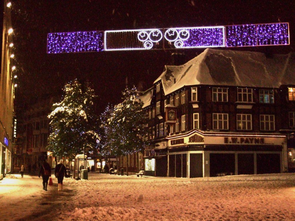 snowy street n black n white building