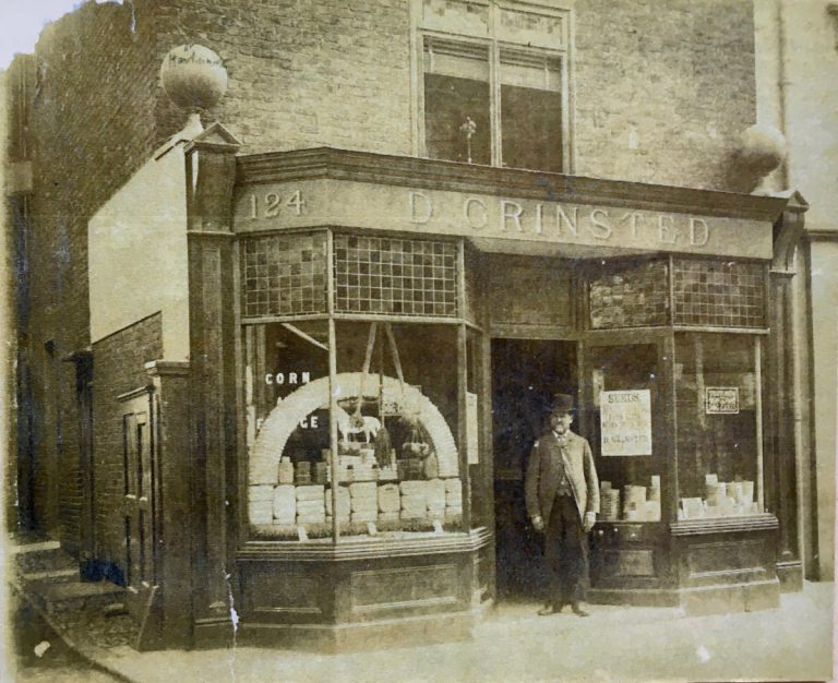 shopkeeper and old fashioned double shop front