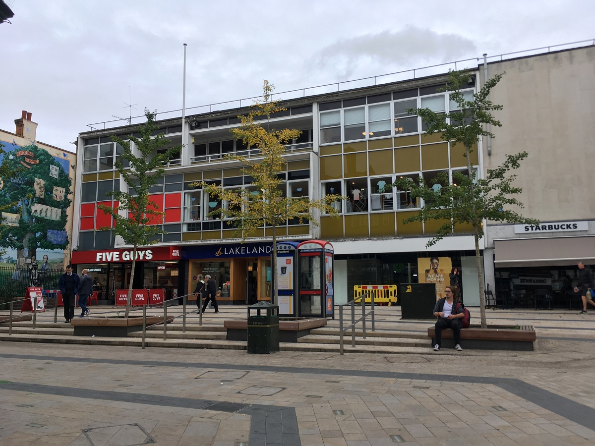 nicely proportioned concrete building with coloured squares