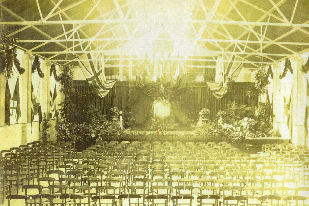 Hall with decorated stage and lots of chairs