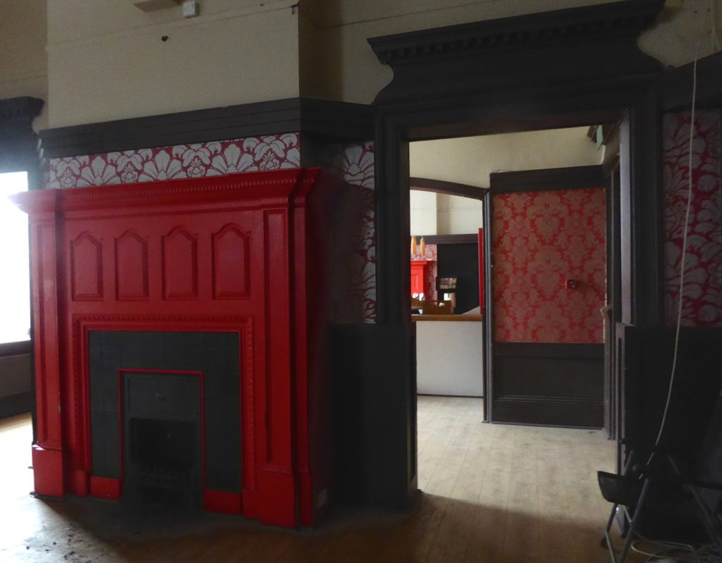 Fireplace and another through a doorway