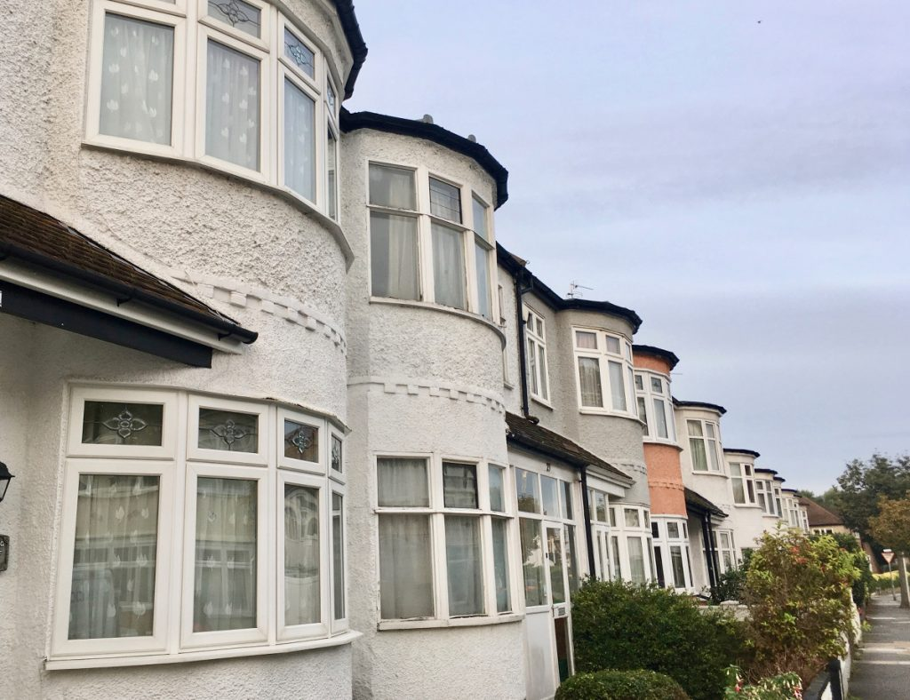 row of semi detached houses with bow windows