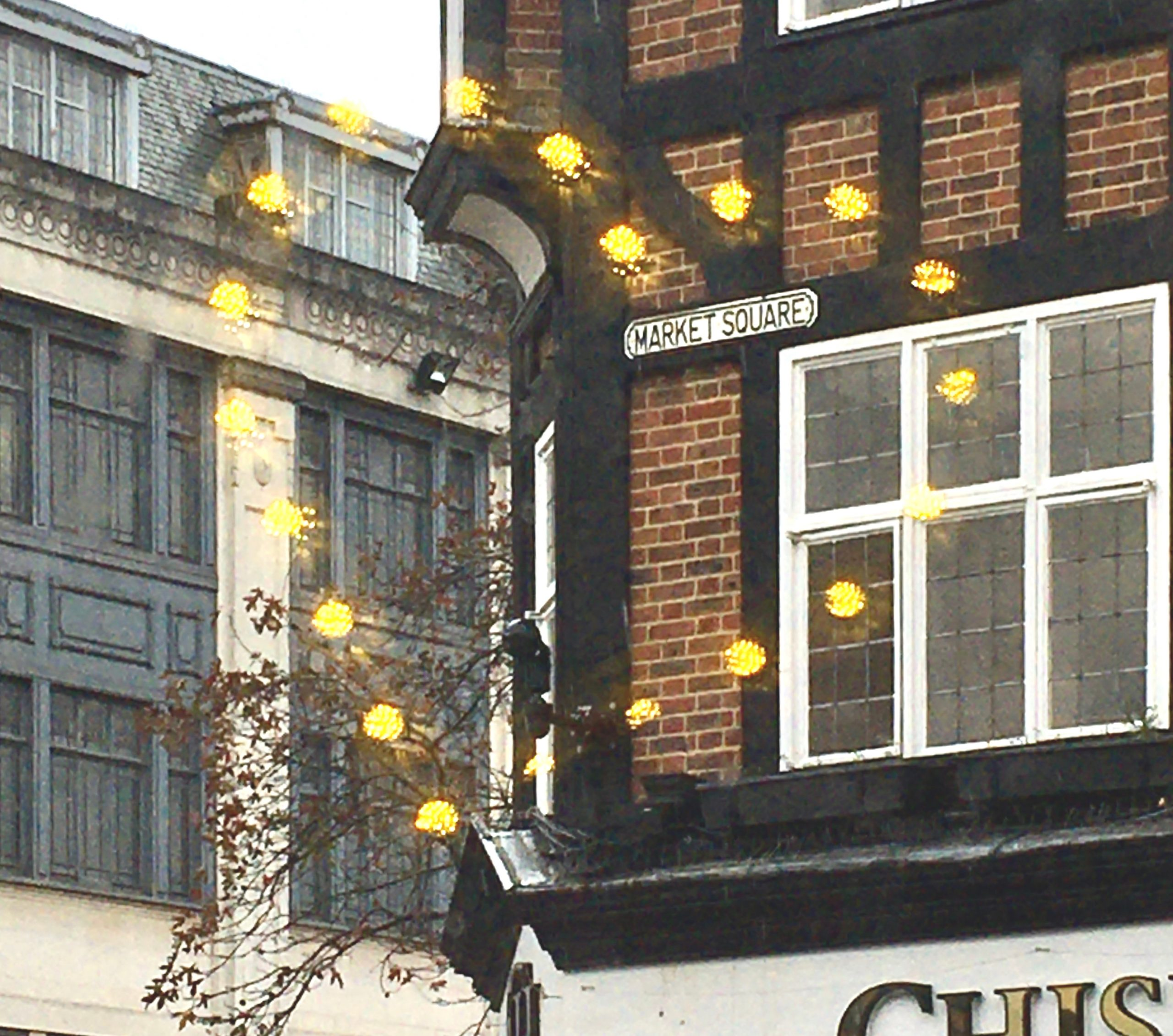 heart of lights around market square roadsign