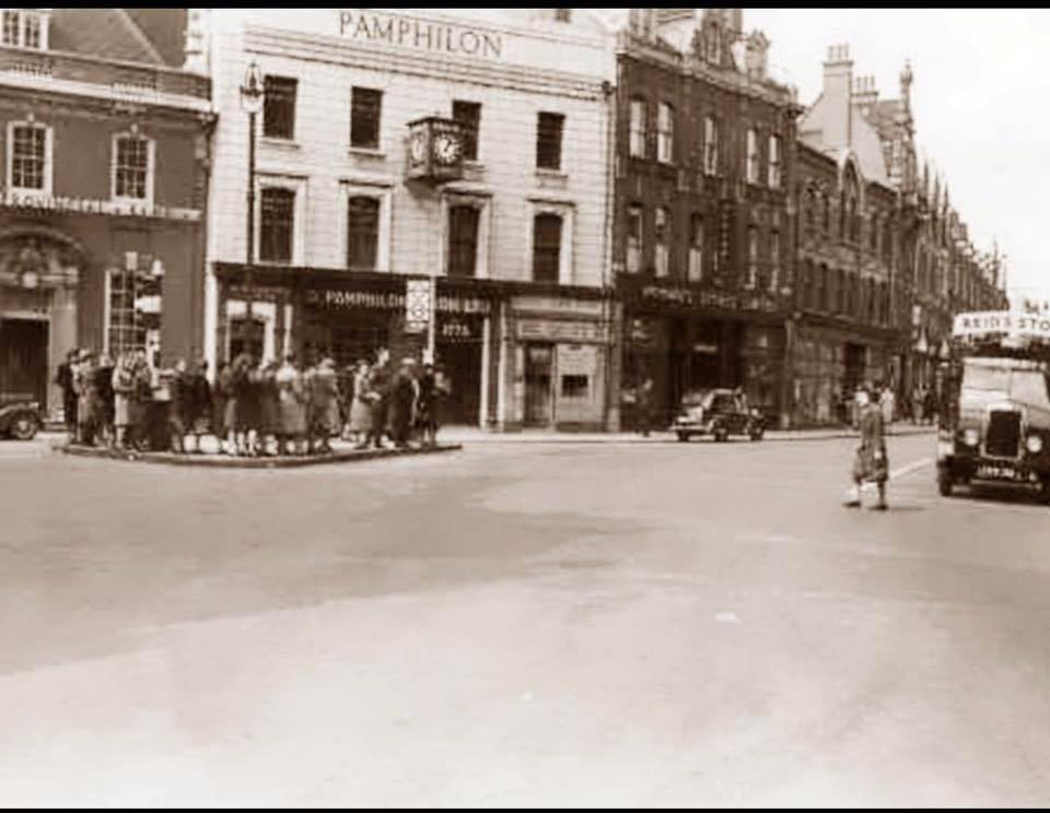 old street scene with 1940s ladies on traffic island