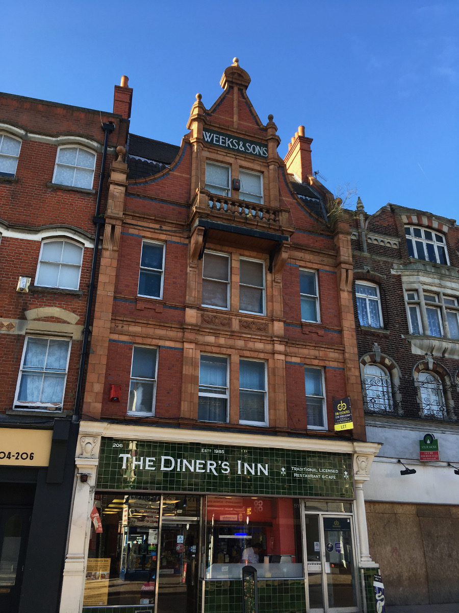 3 storey brick shop with gable front